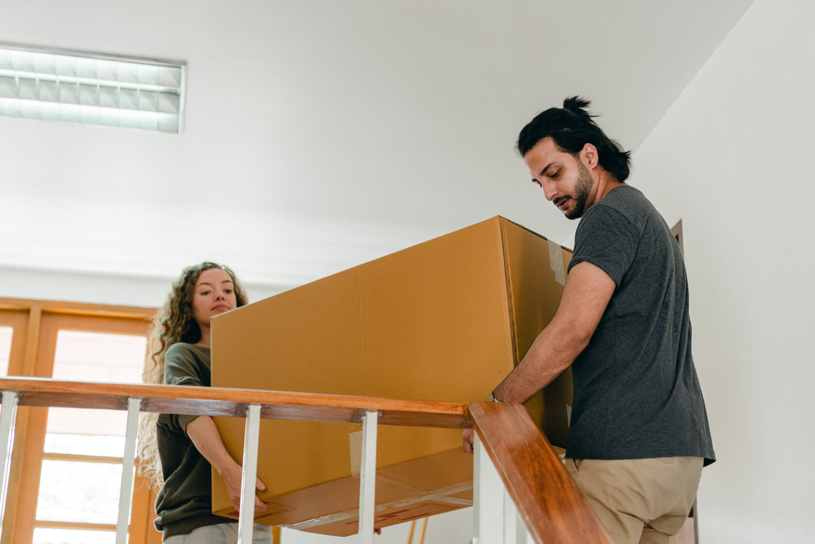 Volunteer helping move furniture
