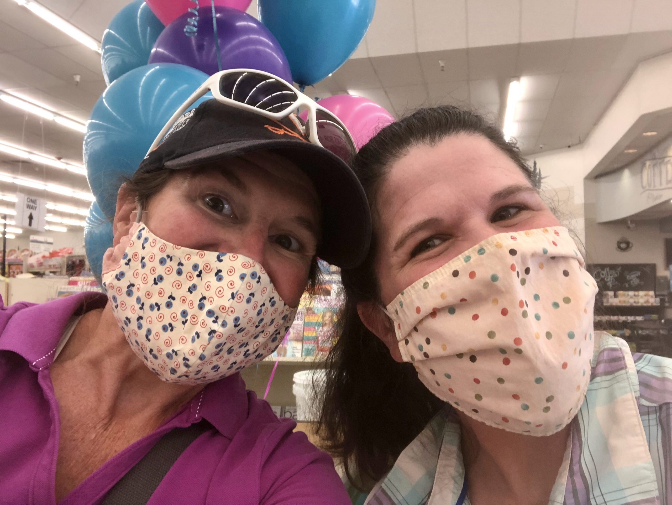 Clair and MJ from Lander Community Foundation wearing masks