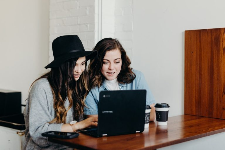 Girls searching computer for virtual volunteer opportunities