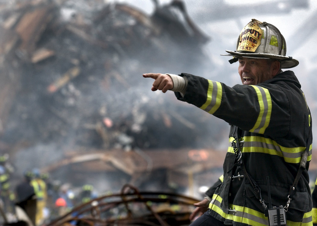 Disaster relief - firefighter pointing on site at fire